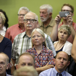 Iowa residents listen as former Florida Gov. Jeb Bush speaks Thursday during a forum sponsored by the Americans for Peace, Prosperity and Security in Davenport, Iowa.