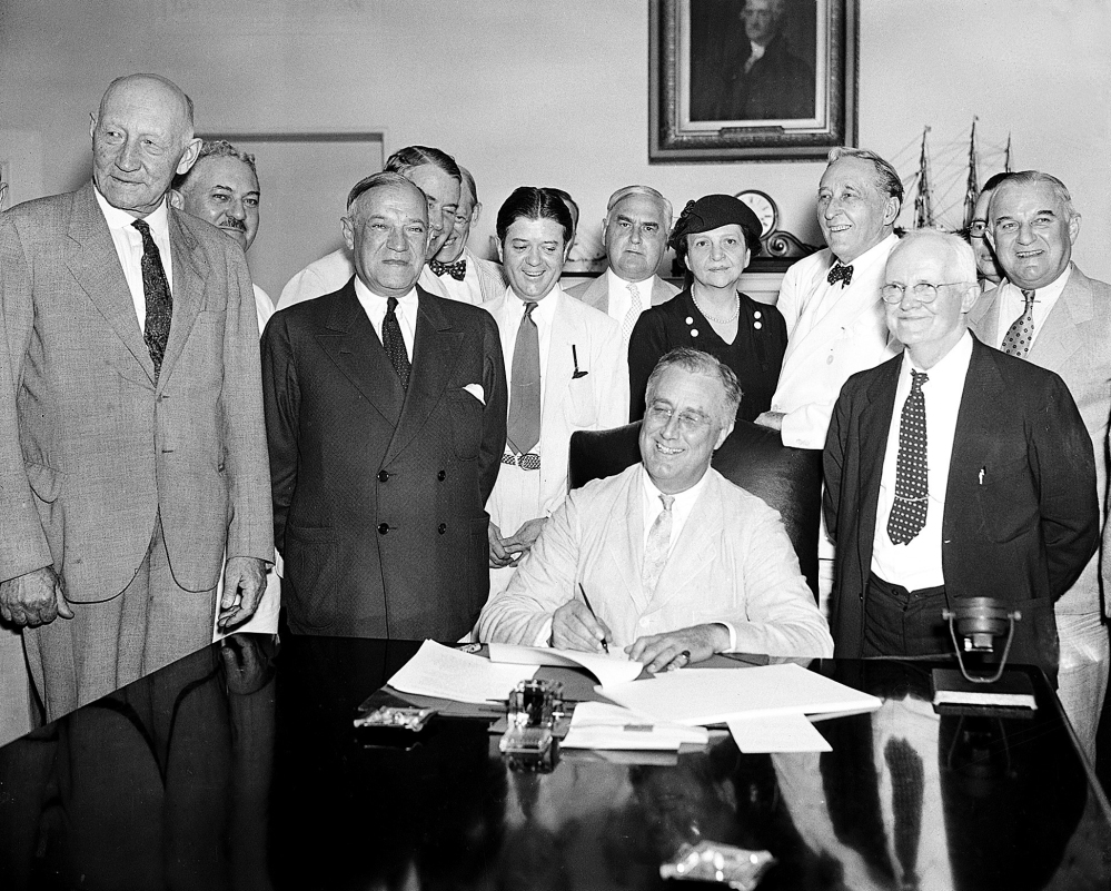 President Franklin Roosevelt signs the Social Security Bill in Washington on Aug. 14, 1935. The retirement fund has enough money to pay full benefits until 2035. But once the fund is depleted, the shortfalls will be enormous.