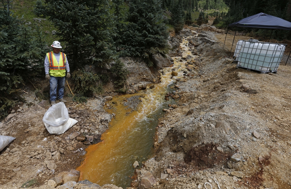 An Environmental Protection Agency contractor works on the cleanup in the aftermath of the blowout at the Gold King mine, which triggered a major spill of toxic wastewater, outside Silverton, Colo., on Wednesday.