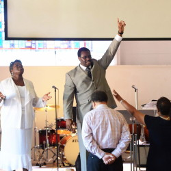 Co-pastor Rhonda Kinsey, left, and senior pastor Mannix Kinsey lead the congregation during a Sunday service at Briar Creek Road Baptist Church in June in Charlotte, N.C. An entire wing of the church was destroyed by an intentionally set fire.
