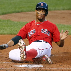 Boston's Xander Bogaerts scores on an RBI double by David Ortiz during the first inning of the Red Sox' 15-1 win over Seattle on Friday in Boston.