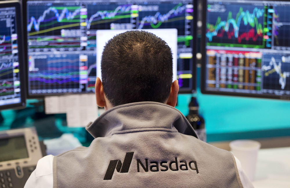 A Nasdaq employee monitors prices at the Nasdaq MarketSite in New York. The tech-driven Nasdaq hit another in a string of all-time highs last month as technology re-established itself as the dominant sector in the U.S. stock market.