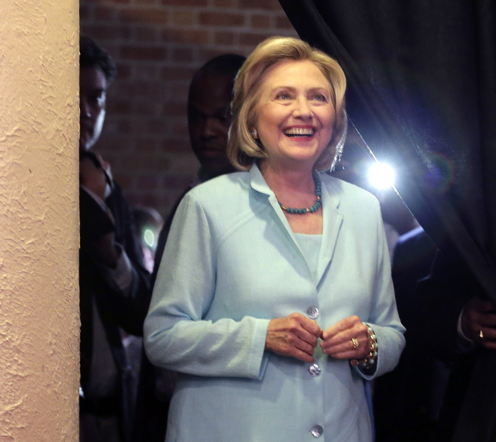The FBI is investigating whether Democratic presidential candidate Hillary Rodham Clinton, waiting to speak at the Iowa Democratic Wing Ding in Clear Lake, Iowa, on Friday, put sensitive information at risk of falling into the wrong hands by using a private email system.