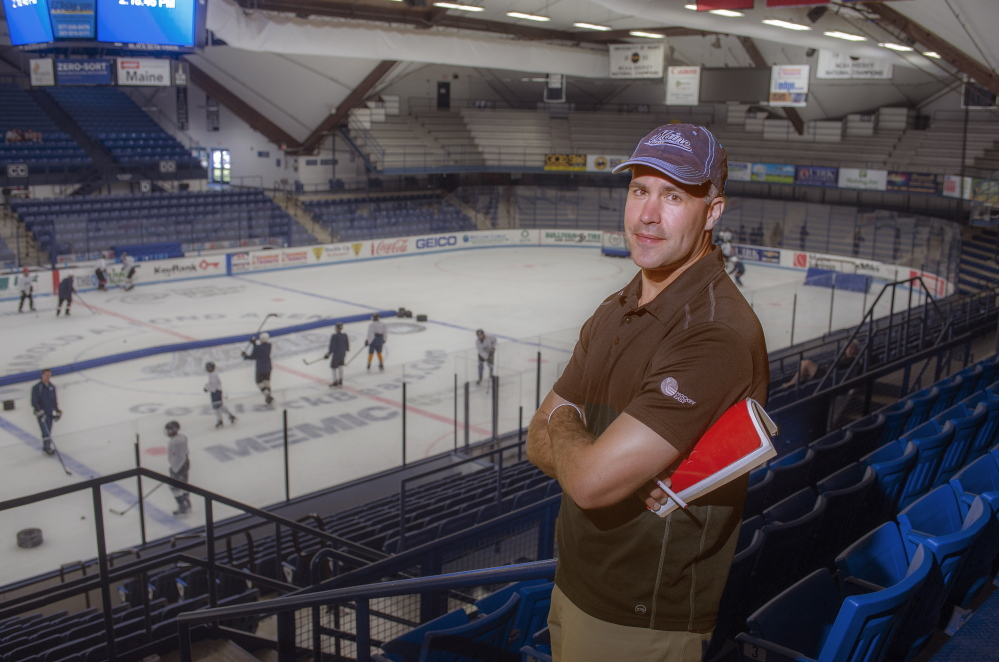 Ben Guite, a star on the Black Bears' 1999 national championship hockey team and now assistant coach for the University of Maine squad, attends a skills development camp for young players at Alfond Arena in Orono. The second-year recruiter plays a lead role in finding talent for the school.