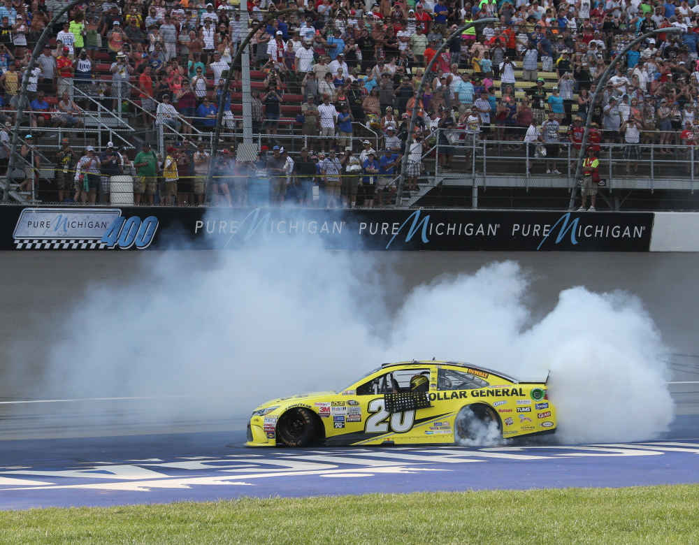 Matt Kenseth celebrates after winning the Sprint Cup race on Sunday at Michigan International Speedway. It was Kenseth's third win of the season.