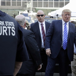 Republican presidential candidate Donald Trump arrives at New York state Supreme Court for jury duty on Monday. Trump is taking a break from courting voters to go to court as a potential juror. He shook hands and fist-bumped bystanders as he reported in Manhattan.