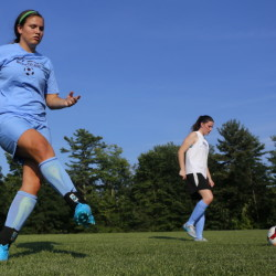 Windham seniors Cierra Berthiaume, left, and Sadie Nelson warm up on the first day of practice Monday in Windham. The Eagles are the two-time defending Class A state champions, but will need to overcome the graduation of eight players to win a third straight.