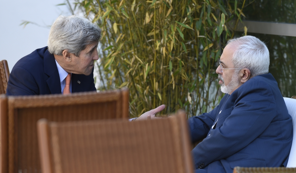 U.S. Secretary of State John Kerry, left, talks with Iranian Foreign Minister Mohammad Javad Zarif in Geneva, Switzerland, in May.