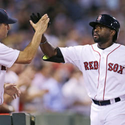 Boston's Jackie Bradley Jr., right, is congratulated by Red Sox interim manager Torey Lovullo after his three-run home run off Cleveland Indians starting pitcher Corey Kluber in the fourth inning at Fenway Park in Boston on Wednesday.