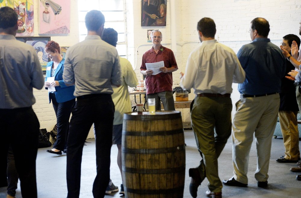 U.S. Rep. Earl Blumenauer, D-Oregon, center, speaks about marijuana issues before a small crowd gathered at the Urban Farm Fermentory in Portland on Thursday.
