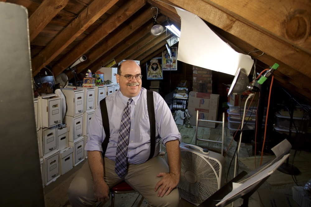 Chad Gilley in the attic of his South Portland home, where with painstaking care he stores the comic books that he has been collecting for more than 30 years.
