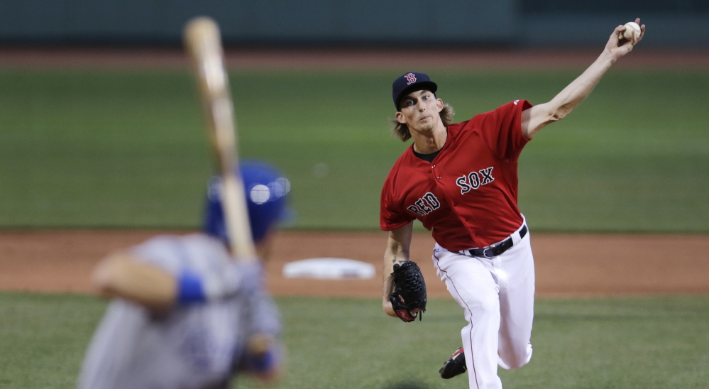 Boston Red Sox starting pitcher Henry Owens delivers a pitch in the first inning of the Red Sox' 7-2 win Friday night in Boston. Owens pitched eight innings to earn the victory.
