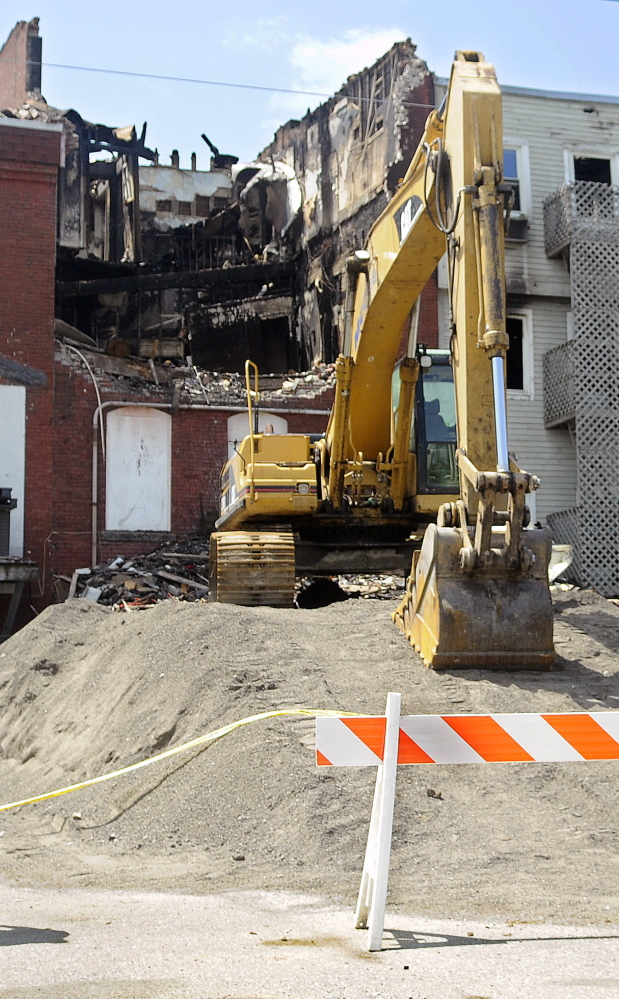 Four days after the July 16 fire, damage is evident on the back side of Water Street buildings in Gardiner.