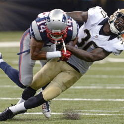 New Orleans Saints defensive back Kenny Phillips tackles New England Patriots wide receiver Chris Harper in the first half of thier preseason game in New Orleans Saturday night.