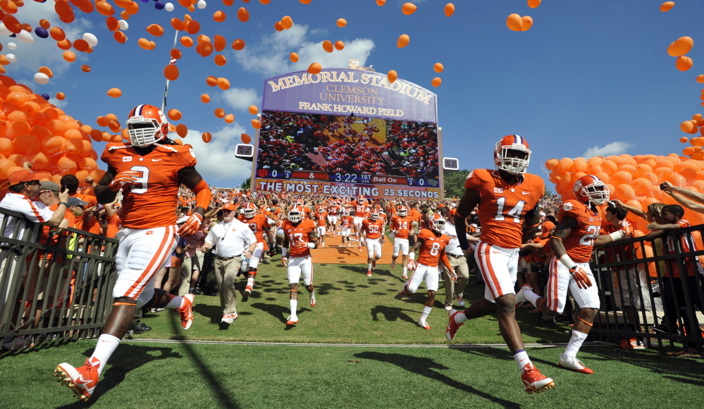 Martin Jenkins, right, a former Clemson player, is one of the plaintiffs in an ongoing lawsuit attempting to eliminate compensation limits for college athletes.