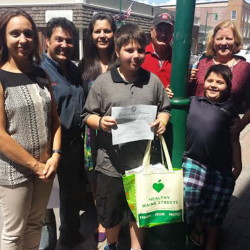 Mason Curtis, center, of Rockland was recognized recently with a certificate of appreciation and gift cards for his volunteer efforts to keep the streets of Rockland clean. With him, from left, are Sierra Dietz, president of the board of directors of Rockland Main Street Inc., and owner of the Grasshopper Shop; Mason's parents, Jeff and Terry Curtis; grandparents Ed and Shelley Curtis; and brother Miles Curtis.