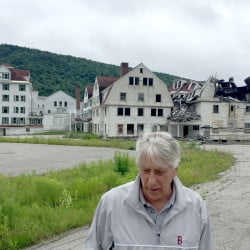 Dixville Notch, New Hampshire, has garnered attention from the media and politicians since it began midnight voting in 1960. Developer Les Otten bought the Balsams Resort, now in ruins, and has plans to turn it into a ski destination.