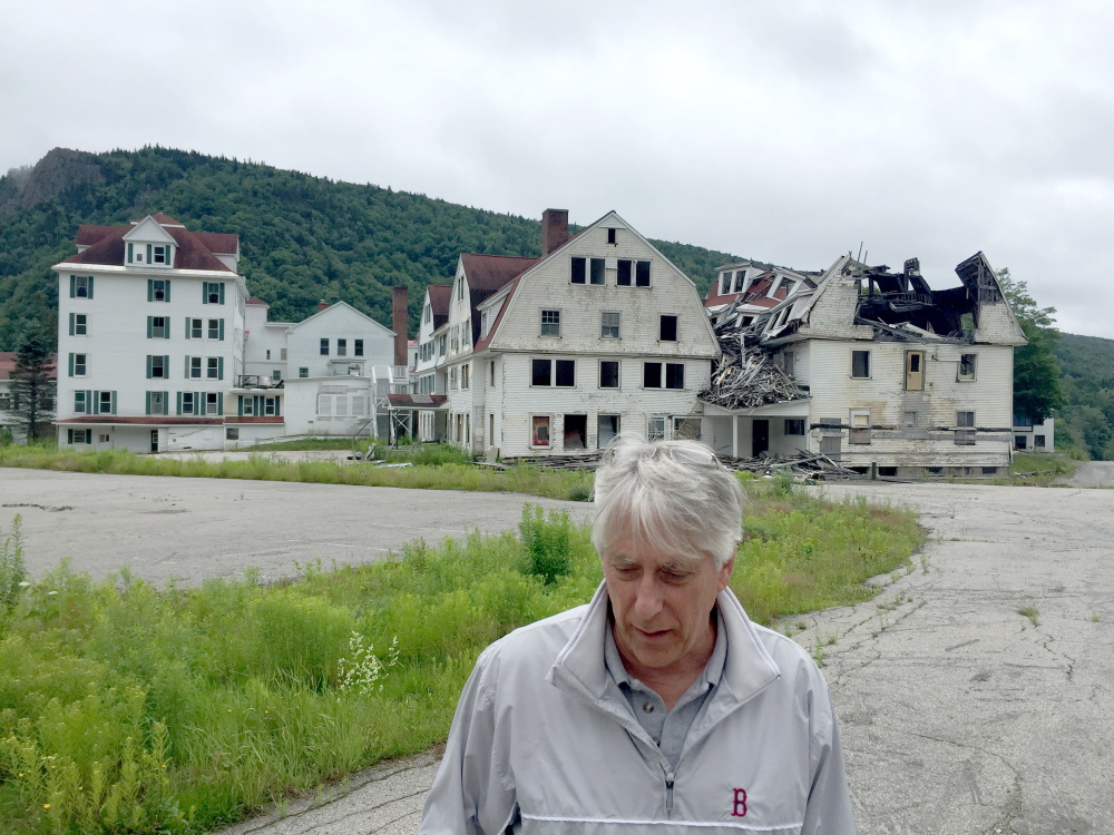 Dixville Notch, New Hampshire, has gotten attention from the media and politicians since it began midnight voting in 1960. Developer Les Otten bought the Balsams Resort, shown in ruins in 2015, and has plans to turn it into a ski destination.