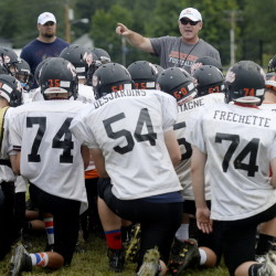Brian Curit, center, is in his second stint as the Tigers' head coach and led Biddeford to its last state title in 1994.