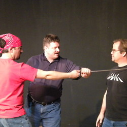 Instructor Jeffrey Eagen, center, shows actors James Paine, left, and Bart Shattuck proper combat technique during training for the Aqua City Actors Theater. The group will close its doors on Main Street in Waterville after a 17-year run at the Studio Theater in The Center.