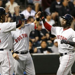 Rusney Castillo, right, celebrates his three-run home run off with Hanley Ramirez, left, and Brock Holt during the Red Sox' 5-4 victory Monday in Chicago.