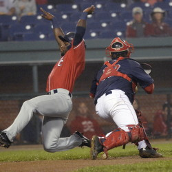 Roemon Fields of the Fisher Cats slides safely around Sea Dogs catcher Tim Roberson during New Hampshire's 3-0 win over Portland on Tuesday at Hadlock Field.