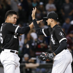 White Sox designated hitter Avisail Garcia, left, celebrates with right fielder Trayce Thompson as Chicago takes a 5-4 win over the Red Sox on Tuesday night. Thompson finished 3 for 4 and was a home run shy of hitting for the cycle.