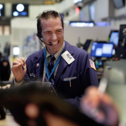 Trader Gregory Rowe works on the floor of the New York Stock Exchange on Wednesday, when U.S. stocks ended a six-day slump and closed sharply higher. The Associated Press