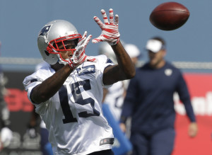 New England Patriots wide receiver Reggie Wayne makes a catch during practice in Foxborough, Mass., on Wednesday, Aug. 26, 2015.