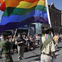 Boy Scouts march during Salt Lake City's gay pride parade in 2014. Mormons make up 20 percent of all Boy Scouts, and the spiritual life of Mormon boys is deeply woven with scouting.
