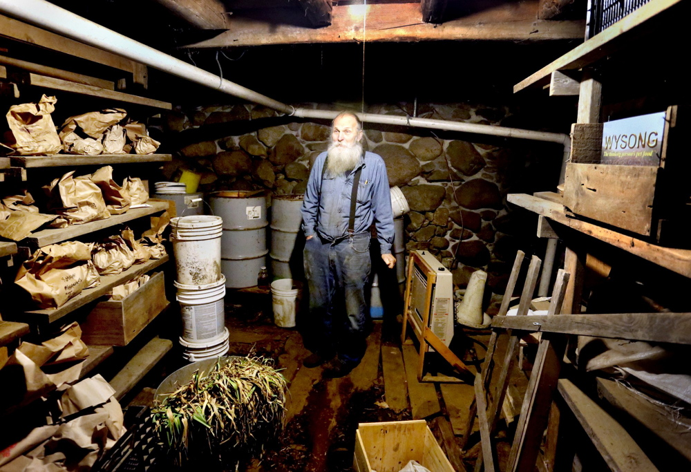 Will Bonsall in his root cellar, where he keeps hundreds of types of potatoes in brown bags to plant at his Industry farm. Maine's seed saving guru, Bonsall will be a keynote speaker at the Common Ground Fair in late September.
