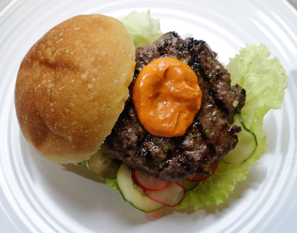 A Korean barbecue burger, made with local grass-fed beef, with homemade quick pickles and spicy mayonnaise.