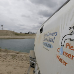 A decal on the dusty tailgate of an Orange County Water District truck promotes water conservation.