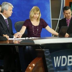 WDBJ-TV7 morning news anchor Kimberly McBroom and meteorologist Leo Hirsbrunner, right, are joined by visiting anchor Steve Grant, second from left, and a Virginia doctor, Thomas Milam, as they observe a moment of silence at the station in Roanoke, Va., Thursday, a day after reporter Alison Parker and cameraman Adam Ward were killed during a live broadcast.