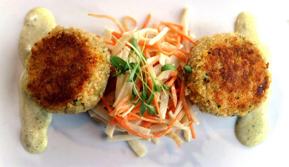 Maine crab cakes with slaw of jicama, carrot and poblano cream.