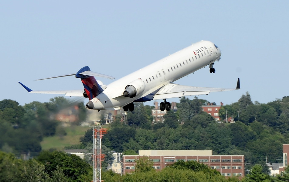 A Delta jet takes off from the Portland International Jetport, where the passenger count has bumped up in 2015 after a rough winter.