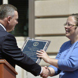 Pastor Jeffrey Fugate gives an award to Kim Davis during a Religious Freedoms Rally. Davis has been sued by the ACLU for denying marriage licenses to same-sex couples.