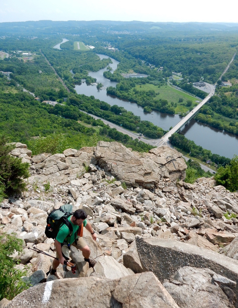 "Bryan ""Walking Home"" Loisel of Gray scrambles up the rocks on Blue Mountain from the Lehigh River Valley in Pennsylvania."