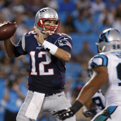 Tom Brady looks to pass under pressure from the Panthers' Wes Horton during the first half Aug. 28. Brady finally got on track late in the first half, after throwing two interceptions.