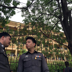 The Associated Press Thai police stand outside an apartment building in Nong Jok on the outskirts of Bangkok on Saturday. Thai police say they arrested a suspect in the blast at the Erawan Shrine on Aug. 17 in this apartment building on Saturday.