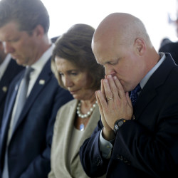 From right, New Orleans Mayor Mitch Landrieu, House Minority Leader Nancy Pelosi, Director of Office of Management and Budget Shaun Donovan and Louisiana Gov. Bobby Jindal bow in prayer during the invocation at a wreath-laying ceremony at the Hurricane Katrina Memorial on Saturday, the 10th anniversary of Hurricane Katrina in New Orleans.