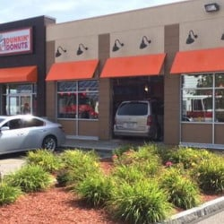 A minivan plowed through a window and into the dining area of the Dunkin' Donuts on Spruce Street Saturday morning, injuring several customers.