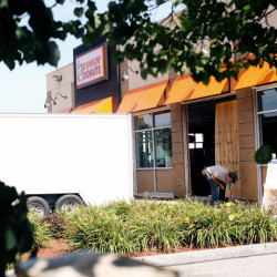 Repairs are made to the Biddeford Dunkin' Donuts on Spruce Street, after a minivan plowed through the side of the building, causing multiple injuries on Saturday.