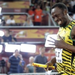 Jamaica's Usain Bolt celebrates after anchoring the team to the gold medal in the men's 4x100m relay at the world championships in Beijing on Saturday.