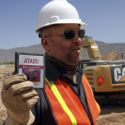 "Zak Penn, director of the film ""Atari: Game Over,"" shows the box of a decades-old Atari ""E.T. The Extraterrestrial"" game found in a dumpsite in Alamogordo, N.M., in 2014."