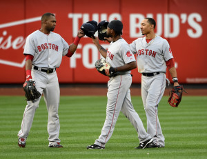 Boston Red Sox's Alejandro De Aza, left, Jackie Bradley Jr., center, and Mookie Betts celebrate their 3-1 win over the New York Mets  at Citi Field on Saturday in New York.