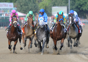 American Pharoah with Victor Espinoza, second from right, leads the field into the first turn during the Travers Stakes horse race at Saratoga Race Course in Saratoga Springs, N.Y., Saturday. The Associated Press/ Will Waldron/The Albany Times Union