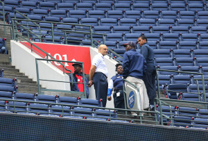 Atlanta Braves employees stand at the portal of section 401 near where fan Gregory K. Murrey, 60, Alpharetta, Ga., fell from the top deck to his death during Saturday's game between the Braves and the New York Yankees, Sunday in Atlanta.