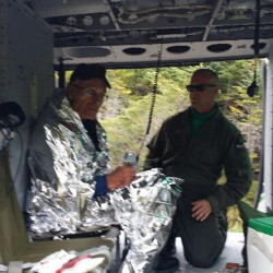 John Lyon of Dumfries, Virginia, sits in a helicopter after being rescued in Baxter State Park on Sunday. He had been missing since Thursday. He was treated Monday for a partially collapsed lung that he suffered when he fell and hit his chest.