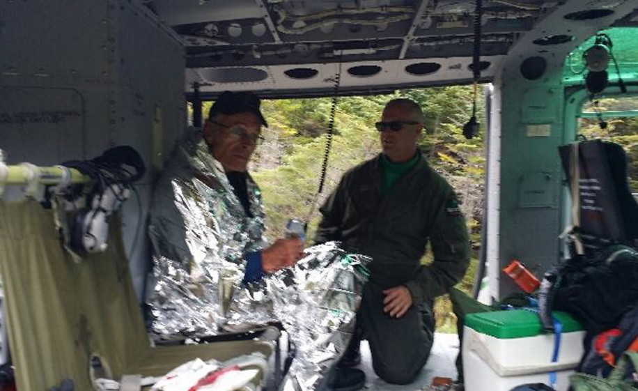 John Lyon of Dumfries, Va., sits in a helicopter after being rescued in Baxter State Park on Sunday. He had been missing since Thursday. He was treated Monday for a partially collapsed lung that he suffered when he fell and hit his chest.